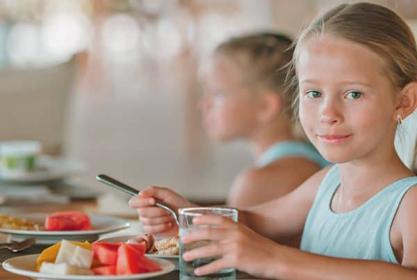 Girl dines at restaurant with family