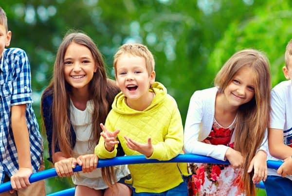 Happy kids on playground during school holidays
