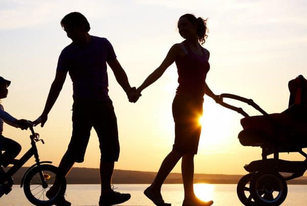 silhouettes of family walking together